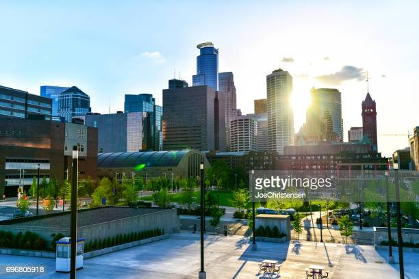 minneapolis skyline and sunbeams - minneapolis stock photos and pictures