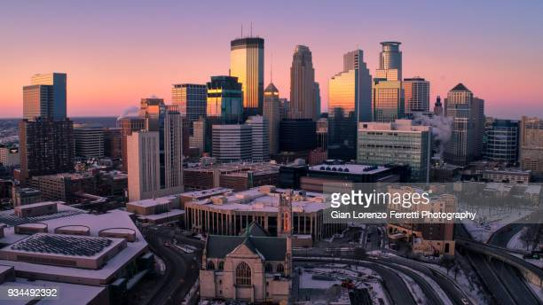 minneapolis skyline at dusk - minneapolis stock photos and pictures
