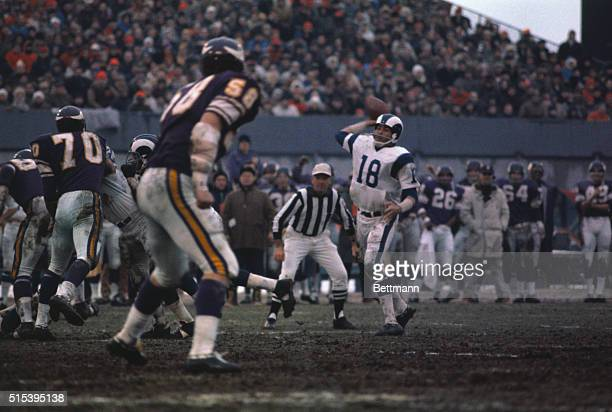 The following action in the third quarter of the NFL playoff here between the Minnesota Vikings and the Los Angeles Rams Rams' Roman Gabriel passes...