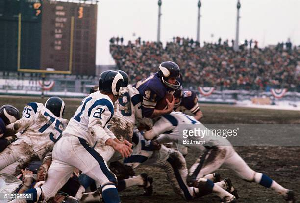 The following action in the third quarter of the NFL playoff here between the Minnesota Vikings and the Los Angeles Rams Vikings' Dave Osborn goes...