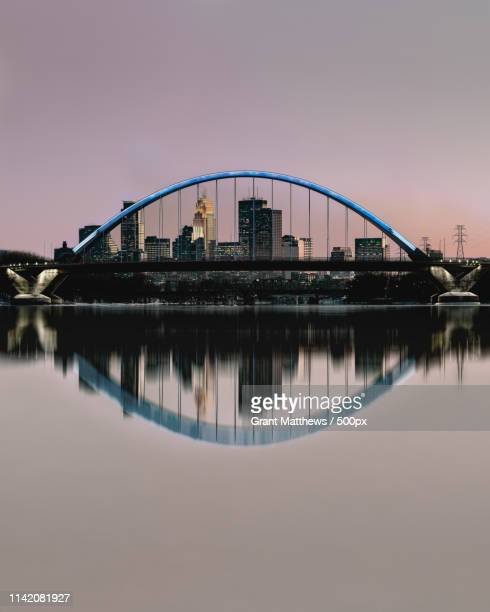 minneapolis through the lowry ave bridge - minneapolis stock photos and pictures