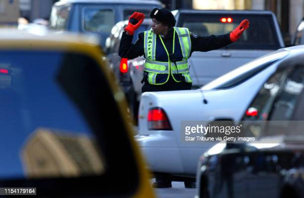 Minneapolis traffic patrol agent Paula Rangel direct the evening rushhour traffic at the intersection of 7th and Marquette Ave in downtown Minneapolis