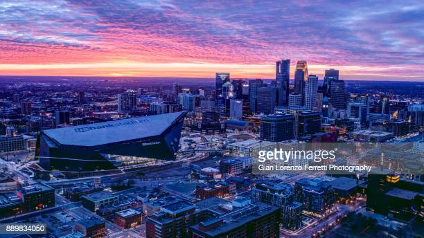 minneapolis, usa - november 26, 2017 - us bank stadium and downtown minneapolis at sunset. - minneapolis stock photos and pictures