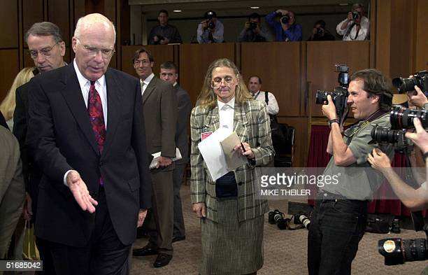 Minneapolisbased FBI Agent Colleen Rowley is shown her seat in the Senate Judiciary Committee room by Senator Patrick Leahy DVT 06 June 2002 on...