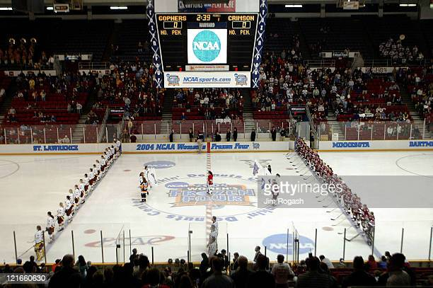 Minnesota and Harvard University stand for the National Anthym before the start of the final round of the NCAA 2004 Women's Frozen Four at the...