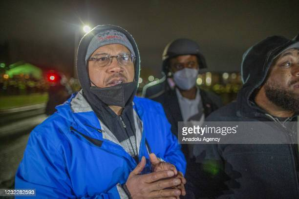 Minnesota Attorney General, Keith Ellison talks to protestors as he pleads for protesters to disperse and head home as protests over police killing...