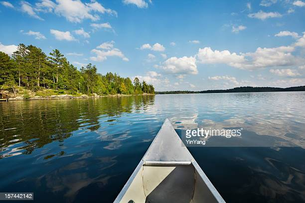 minnesota boundary waters canoe area, canoeing in scenic lake landscape - minnesota stock pictures, royalty-free photos & images