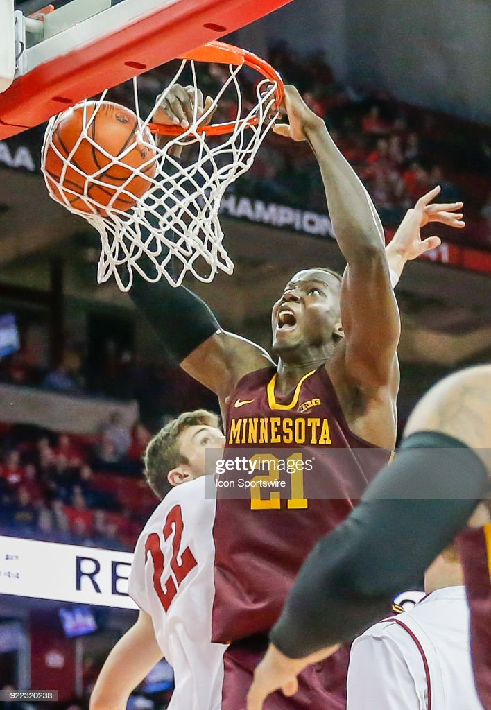Minnesota center Bakary Konate (21) dunks the ball past Wisconsin forward Ethan Happ (22) during a college basketball game between the University of Wisconsin Badgers and the University of Minnesota Golden Gophers on February 19, 2018 at the Kohl Center in Madison, WI. Wisconsin defeated Minnesota by a score of 73 - 63.