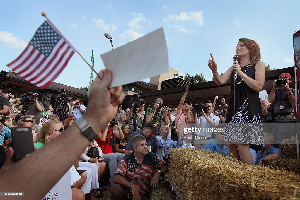 Minnesota Congresswoman and Republican presidential candidate Michele Bachmann talks to voters from the Des Moines Register's Soapbox during the second day of the Iowa State Fair August 12, 2011 in Des Moines, Iowa. Most of the Republican presidential hopefuls are visiting the fair ahead of Saturday's Iowa Straw Poll to greet voters and engage in the traditional Iowa campaigning ritual.