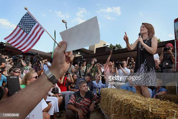 Minnesota Congresswoman and Republican presidential candidate Michele Bachmann talks to voters from the Des Moines Register's Soapbox during the...