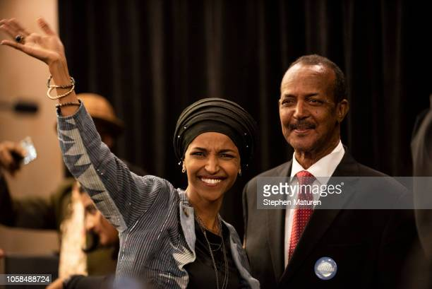 Minnesota Democratic Congressional Candidate Ilhan Omar waves to supporters at an election night results party on November 6 2018 in Minneapolis...