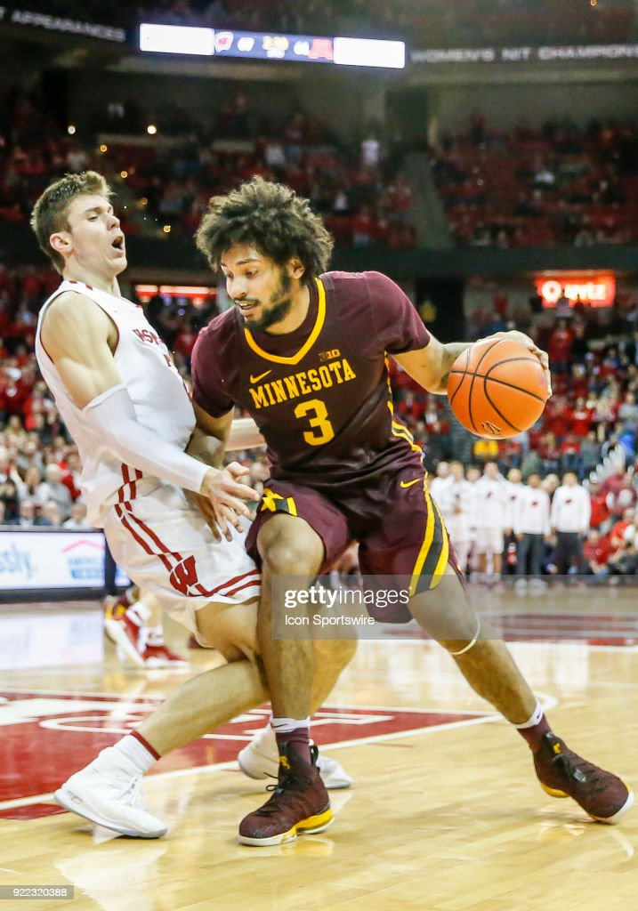 Minnesota forward Jordan Murphy (3) gets called for the charge on Wisconsin forward Ethan Happ (22) during a college basketball game between the University of Wisconsin Badgers and the University of Minnesota Golden Gophers on February 19, 2018 at the Kohl Center in Madison, WI. Wisconsin defeated Minnesota by a score of 73 - 63.