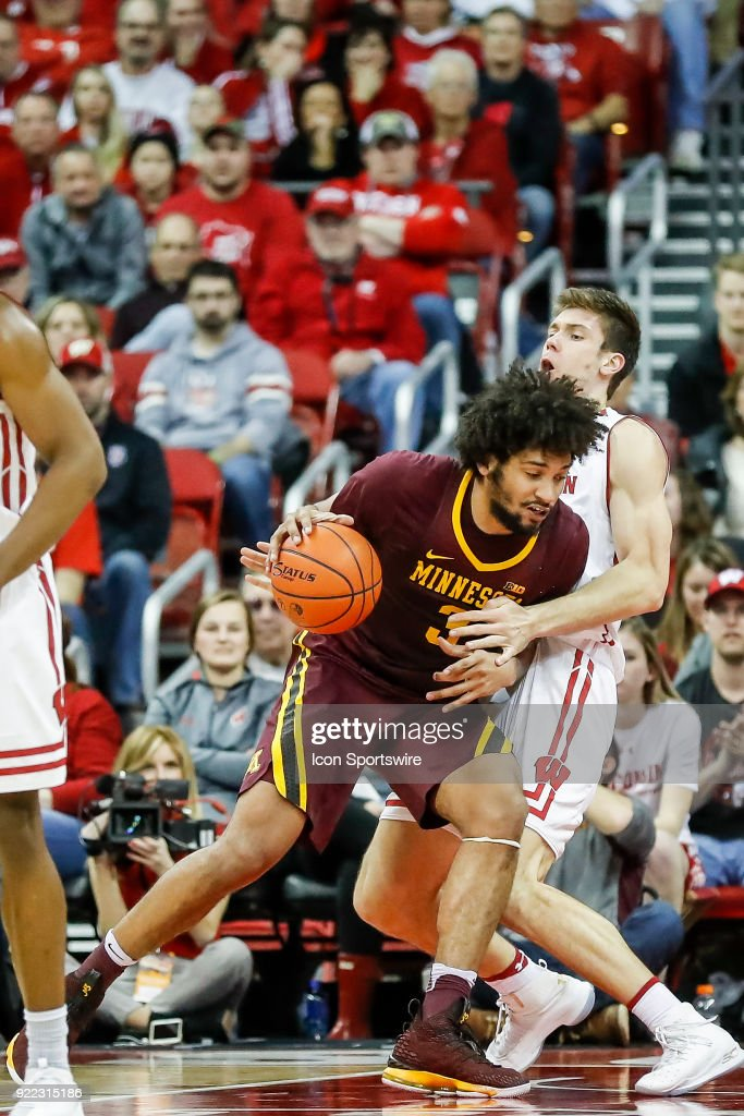 Minnesota forward Jordan Murphy (3) is called for the charge on Wisconsin forward Ethan Happ (22) during a college basketball game between the University of Wisconsin Badgers and the University of Minnesota Golden Gophers on February 19, 2018 at the Kohl Center in Madison, WI. Wisconsin defeated Minnesota by a score of 73 - 63.