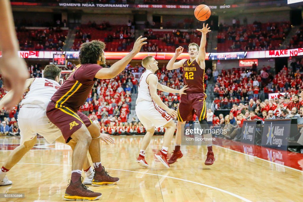 Minnesota forward Michael Hurt (42) passes the ball to Minnesota forward Jordan Murphy (3) during a college basketball game between the University of Wisconsin Badgers and the University of Minnesota Golden Gophers on February 19, 2018 at the Kohl Center in Madison, WI. Wisconsin defeated Minnesota by a score of 73 - 63.