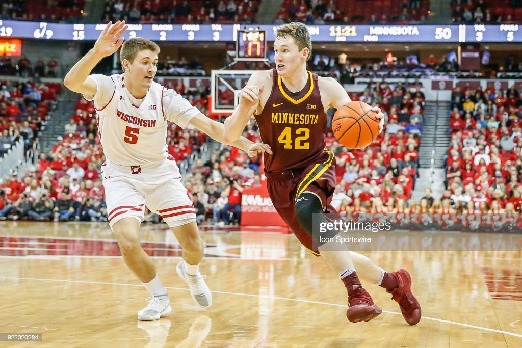 Minnesota forward Michael Hurt (42) tries to get around Wisconsin forward Aaron Moesch (5) during a college basketball game between the University of Wisconsin Badgers and the University of Minnesota Golden Gophers on February 19, 2018 at the Kohl Center in Madison, WI. Wisconsin defeated Minnesota by a score of 73 - 63.