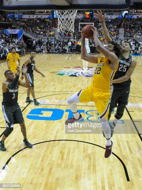 Minnesota Golden Gophers center Reggie Lynch scores against Michigan State Spartans forward Kenny Goins in the third round of the Big 10 Tournament...