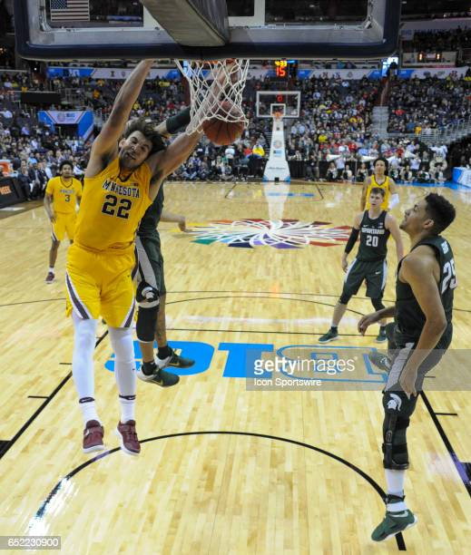 Minnesota Golden Gophers center Reggie Lynch scores on dunk against Michigan State Spartans forward Kenny Goins in the third round of the Big 10...