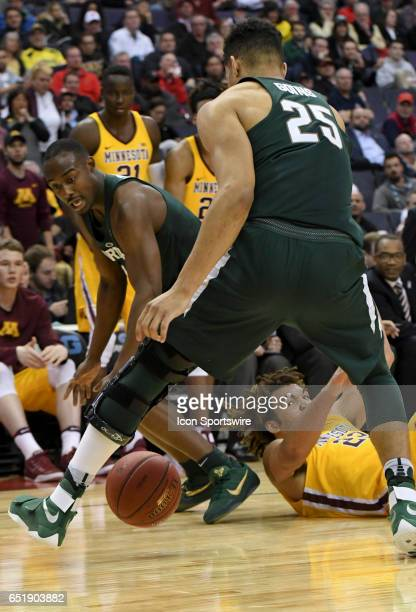 Minnesota Golden Gophers center Reggie Lynch struggles for a loose ball against Michigan State Spartans forward Kenny Goins in the third round of the...