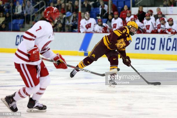 Minnesota Golden Gophers defenseman Emily Brown takes a shot on net during the NCAA women's hockey game between Minnesota Golden Gophers and...