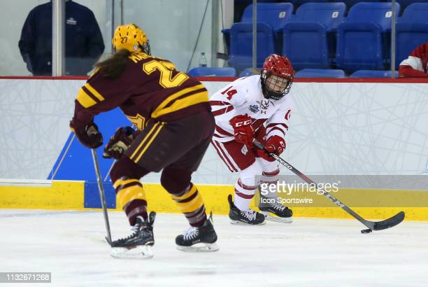Minnesota Golden Gophers defenseman Patti Marshall and Wisconsin Badgers forward Alexis Mauermann in action during the NCAA women's hockey game...