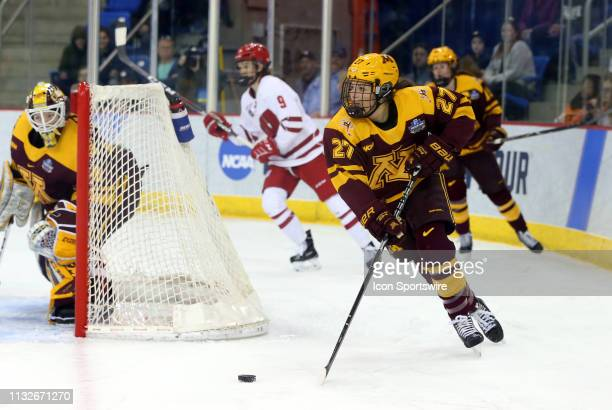 Minnesota Golden Gophers defenseman Patti Marshall skates with the puck during the NCAA women's hockey game between Minnesota Golden Gophers and...
