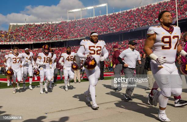 Minnesota Golden Gophers defensive lineman Jamaal Teague and teammates jog off the field after losing a game between the Ohio State Buckeyes and the...