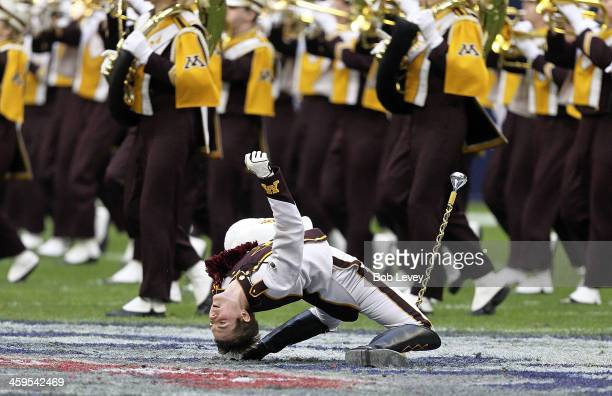 Minnesota Golden Gophers drum major brings the band onto the field at Reliant Stadium on December 27 2013 in Houston Texas