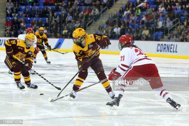 Minnesota Golden Gophers forward Emily Oden passes to Minnesota Golden Gophers forward Nicole Schammel while defended by Wisconsin Badgers defenseman...