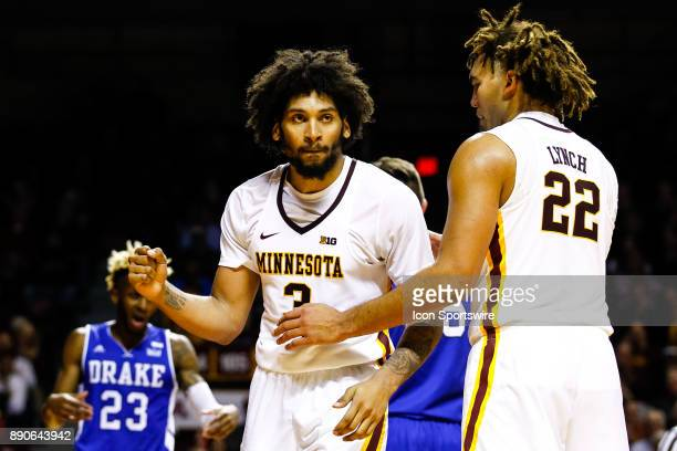 Minnesota Golden Gophers forward Jordan Murphy celebrates with Golden Gophers center Reggie Lynch after Murphy drew a shooting foul in the 2nd half...