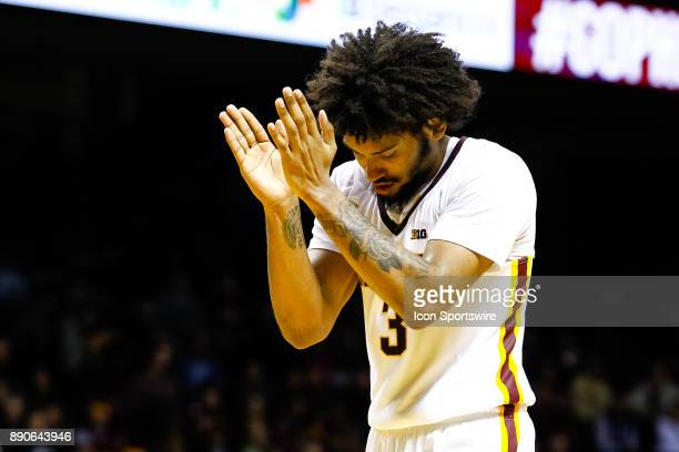 Minnesota Golden Gophers forward Jordan Murphy claps as time runs out in the 2nd half during the regular season game between the Drake Bulldogs and...