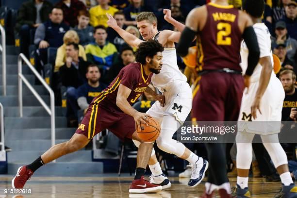 Minnesota Golden Gophers forward Jordan Murphy drives to the basket against Michigan Wolverines forward Moritz Wagner during a regular season Big 10...