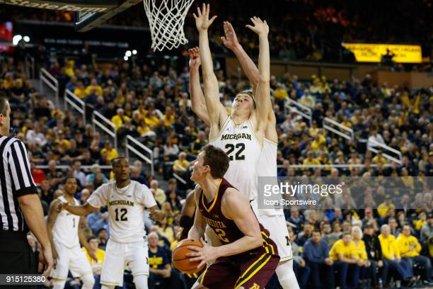 Minnesota Golden Gophers forward Michael Hurt looks to shoot against Michigan Wolverines guard Duncan Robinson during a regular season Big 10...