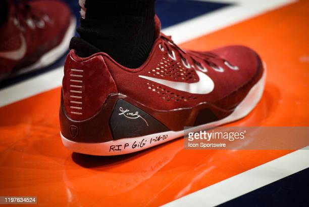 Minnesota Golden Gophers forward Michael Hurt with RIP Gigi 12620 written on his shoe in honor of Kobe Bryan's daughter Gigi Bryant during a college...