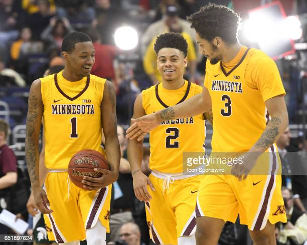 Minnesota Golden Gophers guard Dupree McBrayer guard Nate Mason and forward Jordan Murphy celebrate following the game in the third round of the Big...