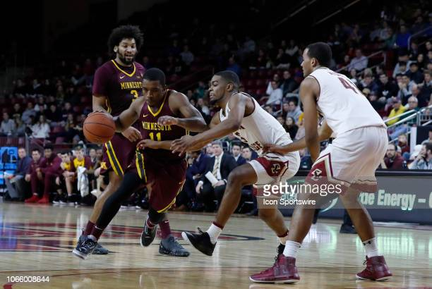 Minnesota Golden Gophers guard Isaiah Washington drives past Boston College guard Winston Tabbs during a game between the Boston College Eagles and...