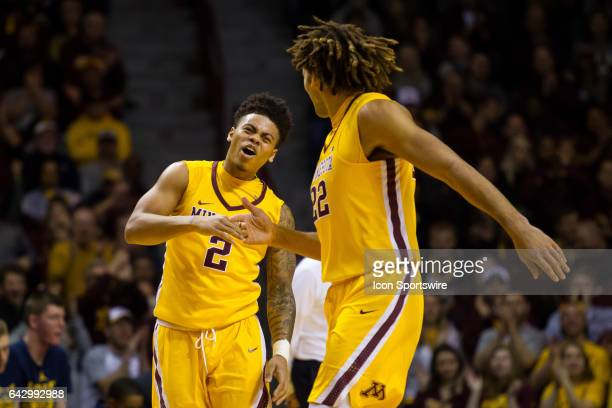 Minnesota Golden Gophers guard Nate Mason and center Reggie Lynch celebrate during the Big Ten Conference game between the Michigan Wolverines and...