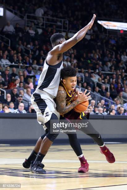 Minnesota Golden Gophers guard Nate Mason drives to the bakset against Providence Friars guard Isaiah Jackson during a college basketball game...