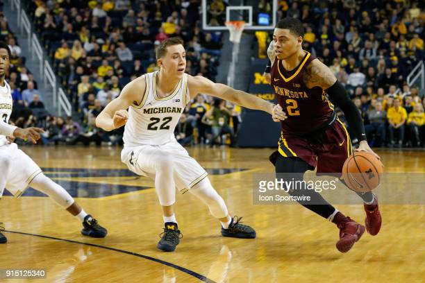 Minnesota Golden Gophers guard Nate Mason drives to the basket against Michigan Wolverines guard Duncan Robinson during a regular season Big 10...