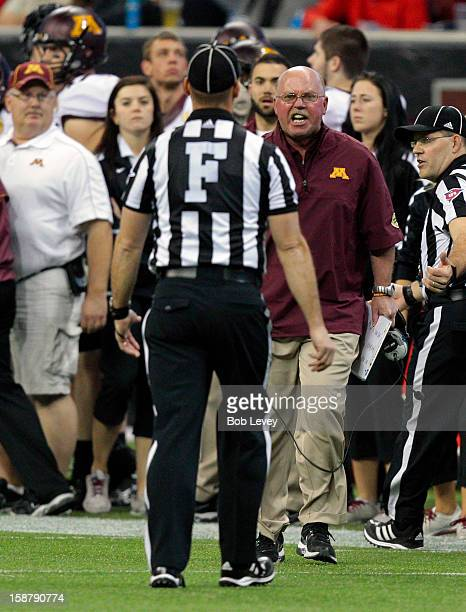 Minnesota Golden Gophers head coach Jerry Kill yells at field judge Matt Kukar after a penalty for unsportsmanlike conduct was called on his player...
