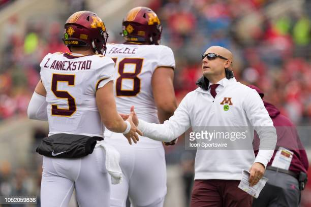 Minnesota Golden Gophers head coach P J Fleck high fives Minnesota Golden Gophers quarterback Zack Annexstad after a play in a game between the Ohio...