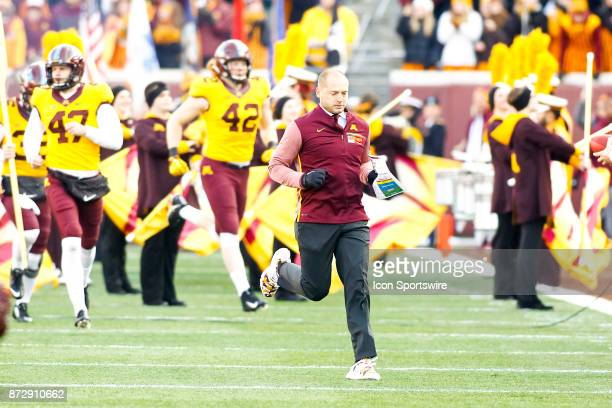 Minnesota Golden Gophers head coach PJ Fleck runs onto the field during the Big Ten Conference game between the Nebraska Cornhuskers and the...