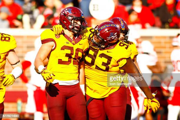Minnesota Golden Gophers linebacker Blake Cashman left and defensive lineman Merrick Jackson celebrate after Cashman got a sack in the 3rd quarter...