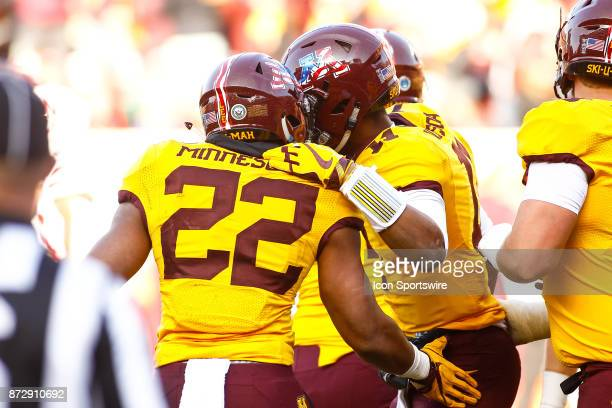 Minnesota Golden Gophers running back Kobe McCrary celebrates with quarterback Demry Croft after Croft rushed for a touchdown during the Big Ten...