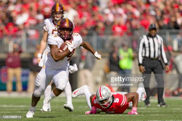 Minnesota Golden Gophers running back Mohamed Ibrahim breaks free of a tackle from Ohio State Buckeyes linebacker Baron Browning in a game between...