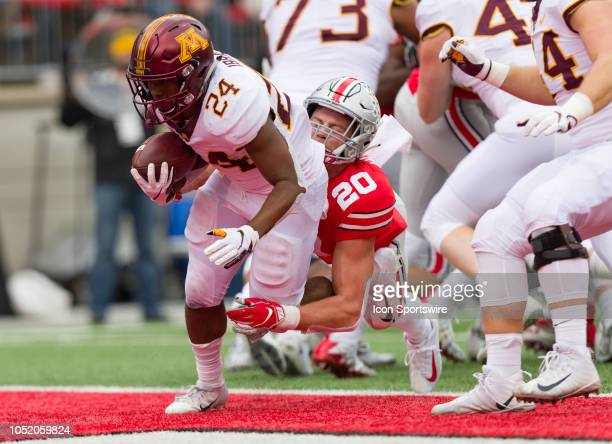Minnesota Golden Gophers running back Mohamed Ibrahim powers through a tackle from Ohio State Buckeyes linebacker Pete Werner for a touchdown in a...