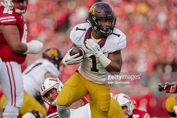 Minnesota Golden Gophers running back Rodney Smith runs toward the end zone durning an NCAA Football game between the 6th ranked Wisconsin Badgers...