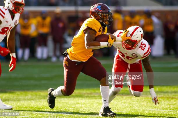 Minnesota Golden Gophers running back Rodney Smith stiff arms Nebraska Cornhuskers safety Antonio Reed in the 2nd quarter during the Big Ten...