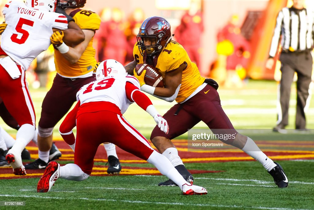 Minnesota Golden Gophers running back Rodney Smith (1) tries to juke past Nebraska Cornhuskers defensive back Marquel Dismuke (19) in the 3rd quarter during the Big Ten Conference game between the Nebraska Cornhuskers and the Minnesota Golden Gophers on November 11, 2017 at TCF Bank Stadium in Minneapolis, Minnesota. The Gophers defeated the Cornhuskers 54-21.