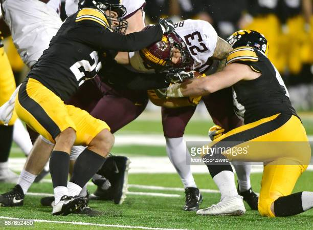 Minnesota Gophers tailback Shannon Brooks is tackled after a short run during a Big Ten Conference football game between the Minnesota Golden Gophers...