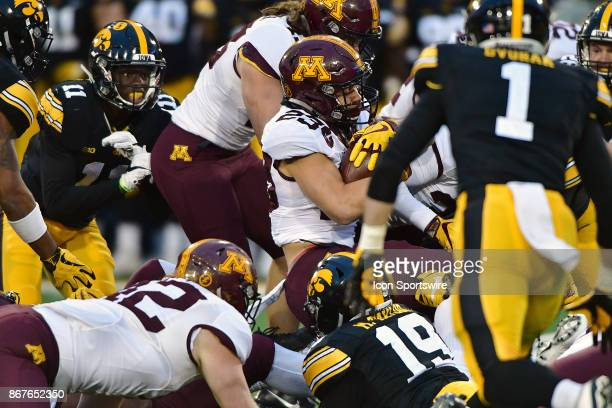 Minnesota Gophers tailback Shannon Brooks runs into the Iowa line during a Big Ten Conference football game between the Minnesota Golden Gophers and...